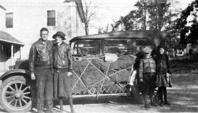 family standing in front of loaded 1919 Buick